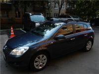Автобагажник Thule  Astra H c аэродинамическими поперечинами